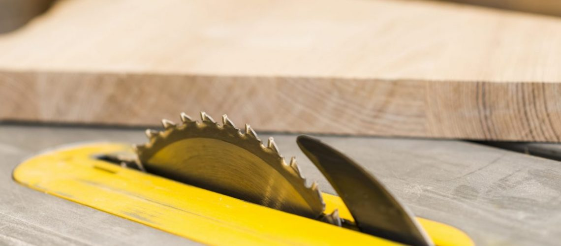 circular-sharp-saw-wooden-table